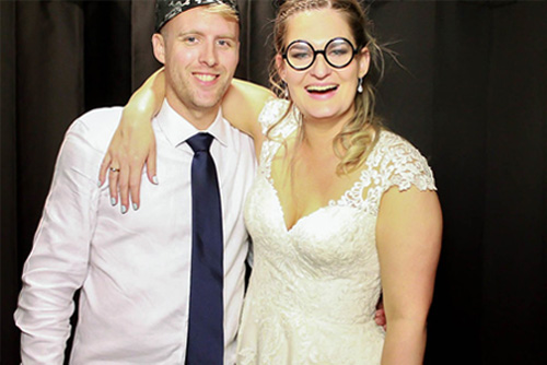 Couple at a Wedding photo booth fun